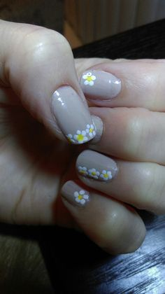"""September 1, 2015. Simple nails; accidentally elegant. Wet n Wild's """"Yo soy"""" with white daisies dotting the edges. Big hit at the office."""