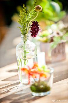 angelic, simple, small clear vases, bright florals, vintage wedding centerpiece ideas. maroon, lavender, oranges  Lauren Sharon Vintage Rentals and Design