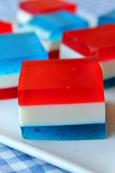 Red, White & Blue Finger Jell-O. ALWAYS a big hit at a 4th of July party.  You can pick them up and eat them, and everyone just ooohs and ahhhs at the festive layers.