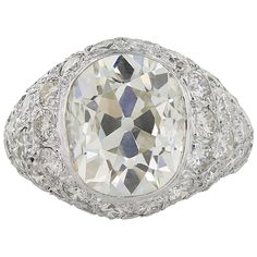 5.74 Carats Cushion Cut Diamonds Platinum Ring   See more rare vintage More Rings at https://www.1stdibs.com/jewelry/rings/more-rings
