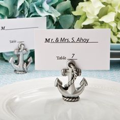 Nautical Anchor Place Card / Photo Holder- Welcome your guests to their tables with a classy ship's anchor displaying their names. If you are searching for a nautical themed place card holder with a difference, this is the perfect option. Wedding Places, Wedding Place Cards, Wedding Stuff, Wedding Things, Destination Wedding, Nautical Wedding Favors, Wedding Favors Unlimited, Nautical Anchor, Nautical Theme