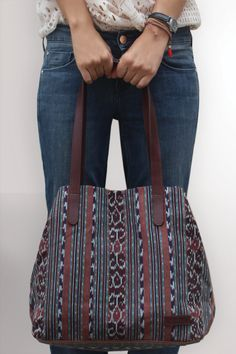 The classic and loved by every woman tote bag twisted into an original and outstanding hand loomed ikat bag.