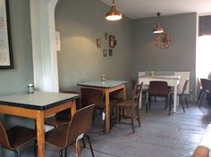 The Greedy Cow Eatery in Margate - Formica tables and lamp room grey; effortlessly cool