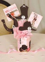 cowgirl baby shower centerpiece. @Robyn Hawkins it would be pretty easy to put something like this together, just more personalized