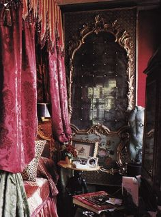 A set of heavy scarlet velvet bed curtains across from a huge gilt-framed mirror remind me of some vintage theaters I've come to know, such as The Majestic on Elm St. in Dallas, TX (NEXT).  Romany Soup: Sumptuous dwellings!