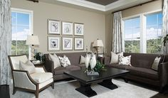 The tray ceiling is perfect for this elegant living room in Arvada, CO.