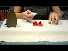 ::Tutorial: Folded Circle Centerpiece:: Learn from Kathy Seal, owner of The Quilt Patch in Tecumseh, MI, from the comfort of your home! In this demonstration, Kathy teaches you how to make DJ Richards Design's Folded Circle Centerpiece. Don't worry--it's MUCH easier than it looks! She also provides helpful tips on using Roxanne's Glue Baste-It.