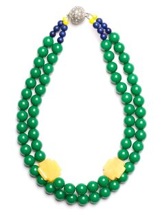 Welcome to the green zone. This elegant double-strand collar necklace features gorgeous beads in a vibrant Kelly green. Adding the chic counterpoint? The cross accents in cheerful sun yellow.  This is part of the Designer Pop-Up: Noble House Designs Collection