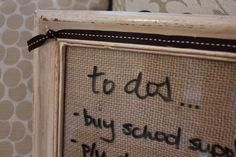 This is a dry erase message board custom made with burlap backing behind the glass. There is a matching burlap rosette to really make you go, Wow, I