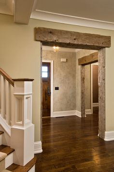 Rustic door frames, I love how the barn wood looks good with the white trim.