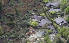Buildings are collapsed by a landslide caused by an earthquake in Minamiaso village, Kumamoto prefecture, Japan, Saturday, April 16, 2016