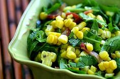 Peppery corn salad with freshly cooked corn, arugula, bacon, green onions, and cumin.