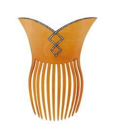 An Art-Nouveau hair comb                                     C. 1900. Horn, silver.