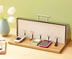 DIY: What a great idea -- breadbox charging station! And I just passed up some really cute breadboxes at Target