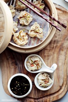 """Chinese Dumplings Dim Sum _ steamed """"open"""" dumplings with minced meat and shrimp. Seasoned with ginger and soy sauce."""