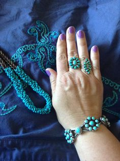 Santo Domingo turquoise necklace by Beatriz Garcia at High Desert Turquoise. Turquoise cluster bracelet by Dean Brown at Select Lines International. Turquoise cluster middle ring by Lorraine Waatsa at eBay. Turquoise cluster ring from gift shop, Cripple Creek CO.