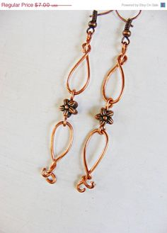 ON SALE Curvy Copper Wire Earrings with a Flower by MultiPolarity