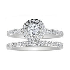 One of the most elegant and beautiful styles of #engagementrings and #bridal sets, is the Micro Pave style. The center piece of the ring is, of course, the gorgeous 1ct round cut center diamond. Delicately placed around the center diamond and along the band are fiery little diamonds that are held into place by tiny prongs giving the overall look of full sparkle and fire!