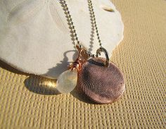 Shabby Chic Designs NEW Copper Clay Rustic Fingerprint Necklace with copper wrapped moonstone. $42.00, via Etsy.