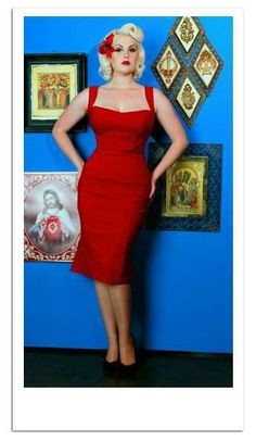 Pinup Fashion: beautiful red dress and cool matching flower. I'm getting one that's similar soon! I'll be sure to post some pics.