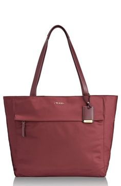 Free shipping and returns on Tumi 'Voyageur - M' Nylon Tote at Nordstrom.com. Stay chic and composed on the go with a perfectly proportioned nylon tote designed to store and organize all your essentials for commutes to the office, jet-setting excursions and more. Smooth leather trim extends the refined style, while water-resistant nylon makes keeping things dry and clean a breeze.