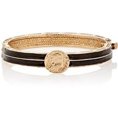 Crafted of antiqued 18k yellow-gold-plated pewter inlaid with matte black enamel,  Maison  Mayle 's Dos Passos hinged bangle features an engraved coin charm at…