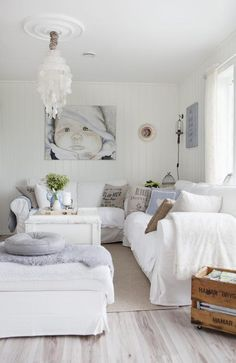 White capos chandelier and ceiling medallion I love white I have a pure white Sectional. I love it