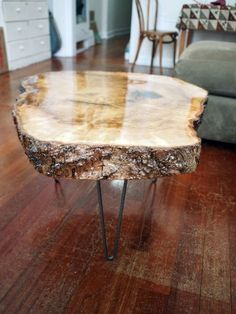 "Check out this guide to finishing a slab of wood into a coffee table. This accent table features a cross-cut maple ""cookie."""