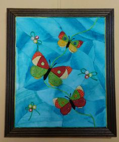 cuadro de mariposas elaborado con la técnica de quilting sin aguja.