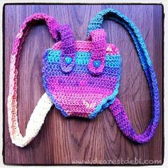 Baby Alive Backpack Carrier - Dearest Debi Patterns - An adorable crochet backpack carrier that fits Baby Alive dolls using Dearest Debi Yarns.
