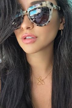 Shay Mitchell wearing Komono Stella Sunglasses in Ivory Demi, Komono Crafted Stella Sunglasses in Ivory Demi and Luv AJ the Cross Stud Chain Earrings