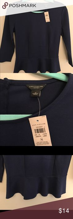 Ann Taylor NWT 3/4 length sleeve Navy knit top New with tags attached cute preppy Ann Taylor 3/4 length sleeve top. Deep navy color. Solid color with peplum ruffle accent on bottom. Zip closure in back. Size small Ann Taylor Tops Blouses