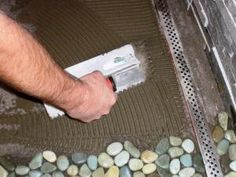 Natural stone tile gives a walk-in shower a relaxing, spa-like feel.