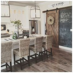 neutral tones textures sliding kitchen barnyard door straw high back stools light fixtures that are modern yet country grey wooden floors - Modern Farmhouse Kitchen