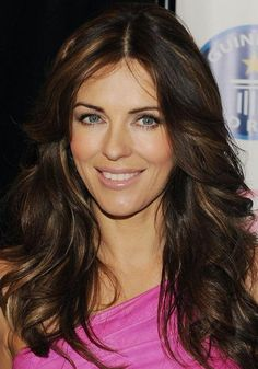 Layered Long Hairstyles Elizabeth Hurley with copper highlights
