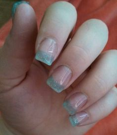 Trendy light blue glitter acrylic nails with gel top coat.