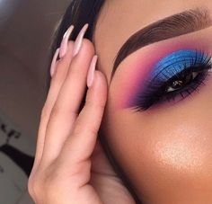 Metallic blue eyeshadow with a hint of purple and pink.