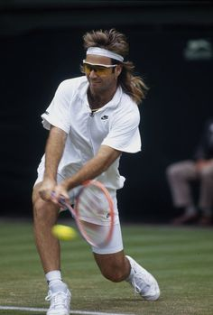 73c8c52f54 Andre Agassi of the USA plays a shot during the Wimbledon Lawn Tennis.
