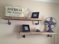 Industrial-style shelves: raw, rough, and heavy solid white oak timber shelves on iron pipe brackets