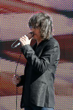Kelly Hansen Photos Photos - Lead singer of Foreigner Kelly Hansen sings the national anthem during pre-race ceremonies prior to the NASCAR Sprint Cup Series AAA Texas 500 at Texas Motor Speedway on November 7, 2010 in Fort Worth, Texas. - AAA Texas 500