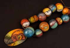 Polymer clay  like the black lines breaking up the colors