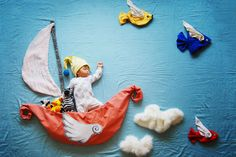 """Adele Enersen from Helsinki, created """"Mila's Daydreams"""" and put together a daily photo diary of her daughter sleeping during her maternity leave. Now, Californian artist Sion Queenie Liao has recreated this original idea with her newborn, Wengenn. Titled """"Wengenn in Wonderland"""" all we can do is coo at pictures of him swinging from the trees as Tarzan, dangling upside down dressed as a mouse with his tail caught in a lion's claw, or getting watered as a budding flower"""