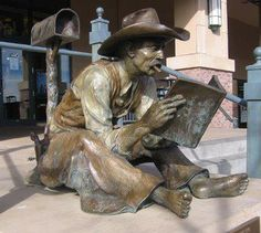 About the bronze statue of the barefoot cowboy reading a book, this magnificent sculpture is located in Colorado.