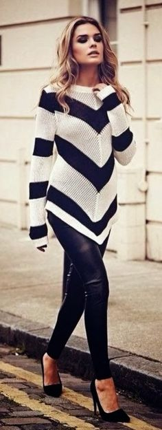 Black and white stripe sweater, black pants, black heels.
