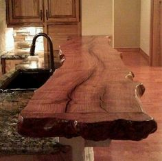 Blog of the day. Live edge ledge(Border is non-linear) on top of speckled granite kitchen island. You can use it for a breakfast bar or simply use it to serve. (The Barn Board and Live Edge Design Company does not take credit for the blog of the day. It is simply giving credit to the true architect and manufacturer.)