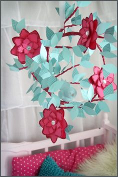 Description:  This was another piece I made to match my daughter's room, I love the color scheme of hot pink and tealy blue! I hand made this piece with tealy blue leaves, hot pink blooms, hot pink glittered limb and a tealy blue baby bird.  It hangs by shear white ribbon.