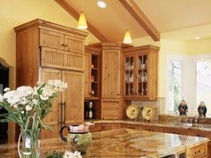 A Beautiful Country Kitchen with a Wood Paneled Refrigerator