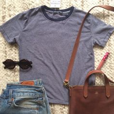 Brandy Melville Jamie Top Super cute and soft. Color is true in model photos. Just have too many striped Tees and missed my chance to return it. Size is Small/medium (one size). Not looking to trade, but open to offers (pls use the offer button). Brandy Melville Tops Tees - Short Sleeve