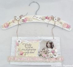 An altered hanger by Marianne for Pion Design. Pion products:  For Mother – Mother's day rose PD2308  For Mother – Cut out PD2314  For Mother – Doily PD2311  From Grandma's Attic ~ Tinted – Girls PD3102