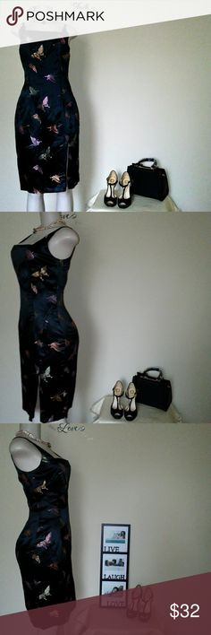 Black Elizabeth Scott Butterfly Dress So gorgeous! This dress looks and feels like satin it has embroidered iridescent butterflies throughout. Size 8, fully lined with a zip front split and back zip closure. It's in great condition with a barely notice snag in the back shown in last pic on zoom.   Bust 36 Waist 30 Hips40 Length 40 Made of 53% rayon 47% nylon - non stretchy dry clean only. Let me know if you have any questions regarding this dress. Elizabeth Scott Dresses